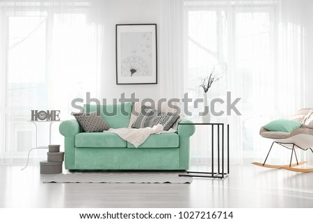 Living room interior with comfortable mint couch #1027216714