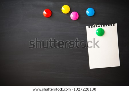sticky paper notes on magnet chalk blackboard with copy space for design or add text message. Education concept.
