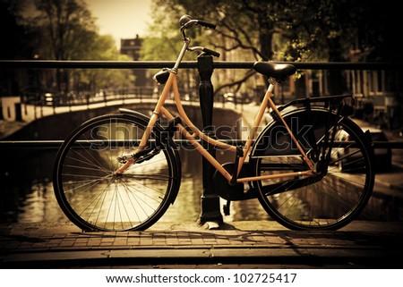 Amsterdam, Holland, Netherlands. Romantic canal bridge, retro bike. Old town