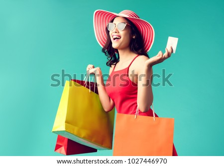 Women are shopping In the summer she is using a credit card and enjoys shopping. #1027446970