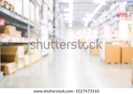 Blur warehouse background, Blurred store factory, industry warehouse space and hardware box for delivery with bokeh light background, business logistic distribution storage cargo concept #1027473160