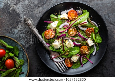 plate of nutritious simple salad with chard, walnuts, soft cheese, onions and oil #1027652830