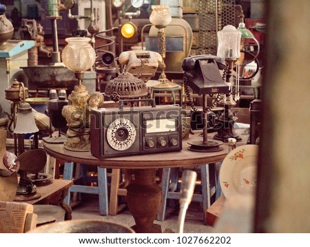 Antique street shop with old, vintage items in Bali. Royalty-Free Stock Photo #1027662202