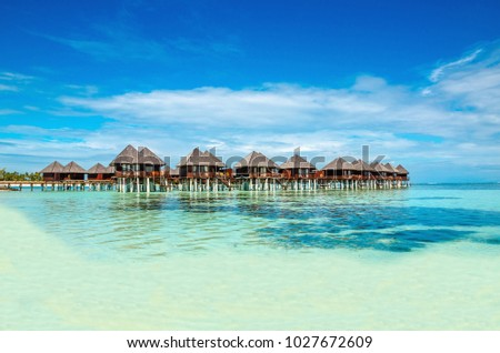 Exotic wooden huts on the water, Maldives #1027672609