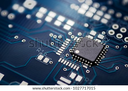 Electronic chip component on the blue printed circuit board #1027717015