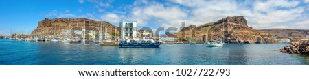 Panoramic view of Puerto de Mogan seaside. Gran Canaria, Canary Islands, Spain  Royalty-Free Stock Photo #1027722793