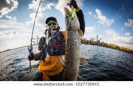 Fishing. Fisherman and trophy Pike. Royalty-Free Stock Photo #1027730692