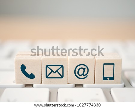 Wood block symbol telephone, mail, address and mobile phone. Website page contact us or e-mail marketing concept #1027774330