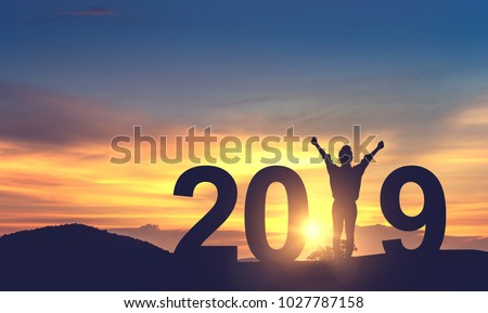 Silhouette freedom young woman Enjoying on the hill and 2019 years while celebrating new year, copy spce. #1027787158
