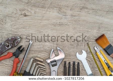Craftsman tools on grunge wooden background. Assorted work tools set for background. #1027817206