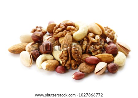 nuts mix for a healthy diet (cashew, pistachios, hazelnuts, walnuts, almonds) Royalty-Free Stock Photo #1027866772