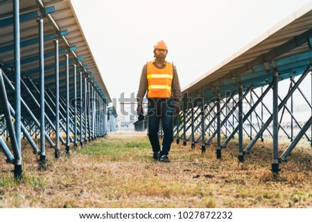 solar power plant to innovation of green energy; engineer or electrician working on checking and maintenance equipment at solar power plant  #1027872232