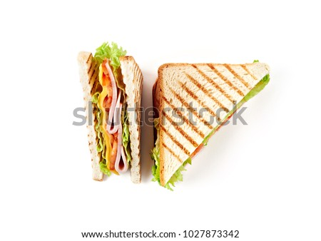 Sandwich with ham, cheese, tomatoes, lettuce, and toasted bread. Top view isolated on white background. #1027873342