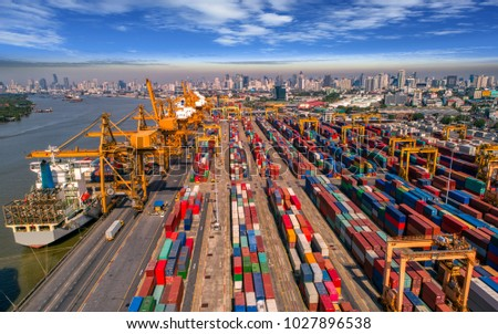 Logistics and transportation of Container Cargo ship and Cargo plane with working crane bridge in shipyard at sunrise, logistic import export and transport industry background #1027896538
