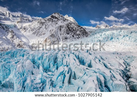 View of Franz Josef Glacier, New Zealand from a helicopter. Royalty-Free Stock Photo #1027905142
