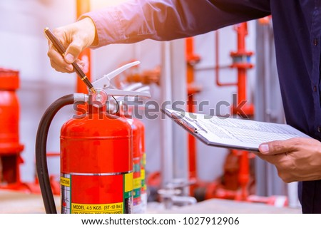 Engineer checking Industrial fire control system,Fire Alarm controller, Fire notifier, Anti fire.System ready In the event of a fire. Royalty-Free Stock Photo #1027912906