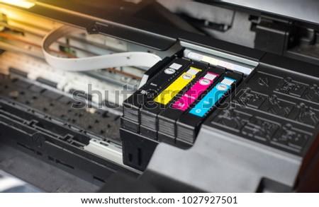 Close up printer ink jet cartridge by selective focus #1027927501