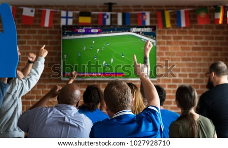 Frieds cheering sport at bar together #1027928710