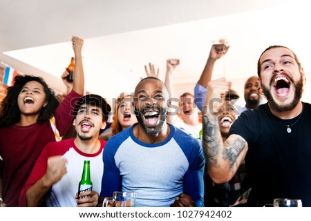 Frieds cheering sport at bar together #1027942402