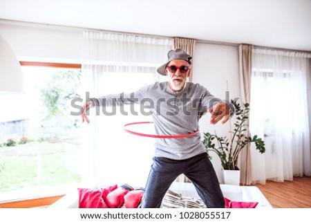 Senior man having fun at home. #1028055517