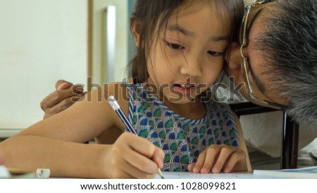 Asian Father and daughter drawing at home #1028099821