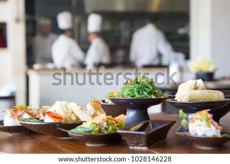Indonesian cuisine - Many traditional Balinese dishes on the table #1028146228