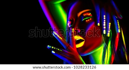 Disco dancer in neon light. Fashion model woman in neon light, portrait of beautiful model girl with fluorescent make-up, Body Art design in UV, painted face, colorful make up, over black background #1028233126