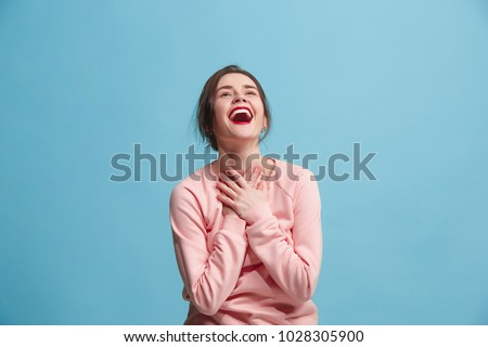 I won. Winning success happy woman celebrating being a winner. Dynamic image of caucasian female model on blue studio background. Victory, delight concept. Human facial emotions concept. Trendy colors Royalty-Free Stock Photo #1028305900