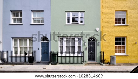 A terrace of small old painted townhouses in the Royal Borough of Kensington and Chelsea, London, UK. #1028314609