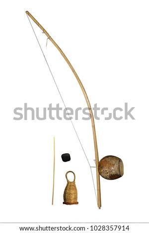 isolated capoeira musical instrument  berimbau with dobrao caxixi and baqueta #1028357914