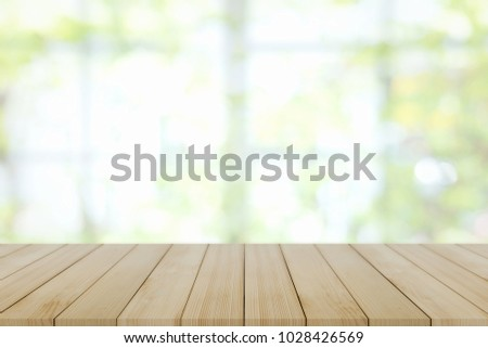 Empty wooden table and window room interior decoration background, product montage display,can be used for display or montage your products.Mock up for display of product. #1028426569