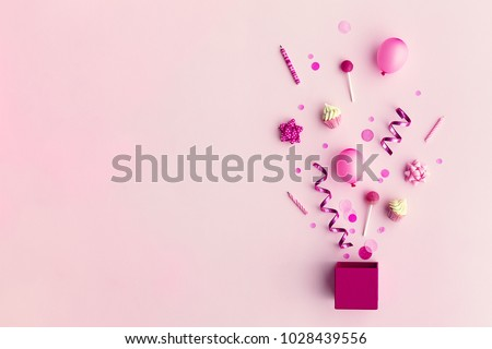 Collection of pink birthday party objects in a gift box #1028439556