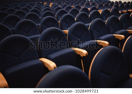 Seats are arranged in row in hall of opera, theater, cinema. Comfortable and soft chairs. #1028499721