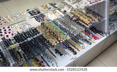 vintage clothes buttons with variety color on sell in market #1028522428