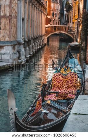 Gondola detail at grand canal Venice, Italy. #1028608453