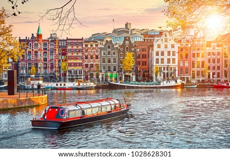 Channel in Amsterdam Netherlands houses river Amstel landmark old european city spring landscape. #1028628301
