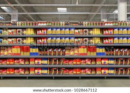 Pasta packaging on shelf Royalty-Free Stock Photo #1028667112