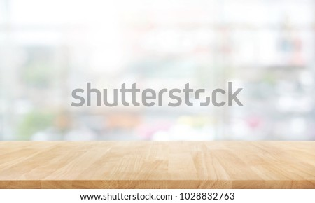 Wood table top on white abstract background form department store.For montage product display or design key visual layout #1028832763