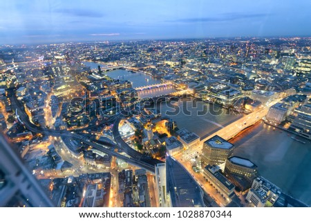 Aerial view of London Bridges and skyline at night, London. #1028870344