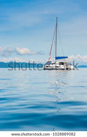 view of the pleasure yacht in the beautiful bay of Thailand, vertical photo #1028889082