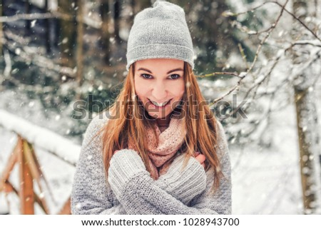 Happy young woman walking in winter time #1028943700