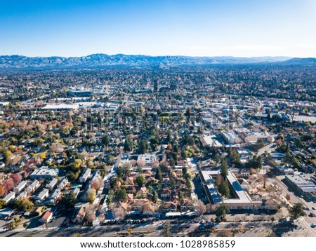 Birds eye view photo of Silicon Valley in California with San Jose downtown on the background