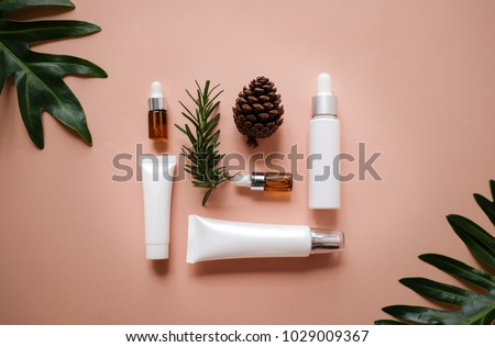 natural cosmetic cream , serum, skincare blank bottle packaging with leaves herb, wood . bio organic product.beauty and spa concept.
