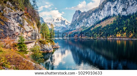 Colorful autumn panorama of Vorderer ( Gosausee ) lake with Dachstein glacier on background. Splendid morning view of Austrian Alps, Upper Austria, Europe. Orton Effect.