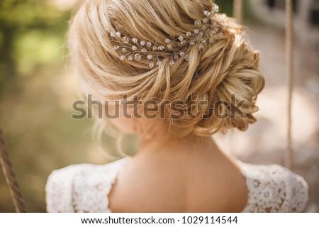 Hair do with an elegant bridal hair accessorie #1029114544