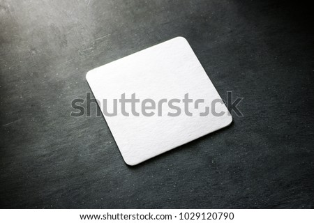 Blank white square beer coaster mockup lying on the textured background. Squared clear design mock up top view. Quadrate cup rug display, isolated. #1029120790
