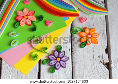 Quilling technique. Paper strips, flowers, scissors, elements. Handmade crafts on holiday theme: Birthday, Mother's Day, March 8, Wedding. Making decoration or greeting card. Children's DIY concept. Royalty-Free Stock Photo #1029134833