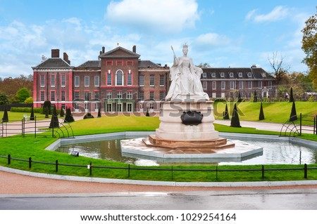 Kensington palace and Queen Victoria monument in London, UK Royalty-Free Stock Photo #1029254164