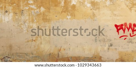 Distressed Yellow Brown Old Brick Wall With Graffiti Street Art. Background And Painted Lines And Draw. Abstract Grunge Modern Grafitty Wallpaper. Abstract Plastered Wall Web Banner. Design Element. #1029343663