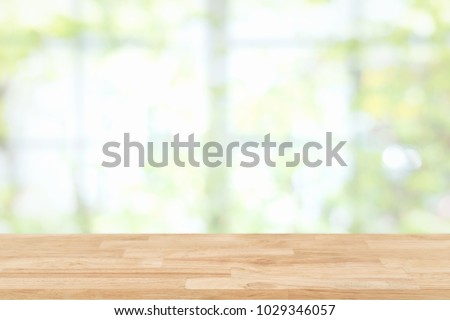 Empty wooden table and window room interior decoration background, product montage display,can be used for display or montage your products.Mock up for display of product. #1029346057